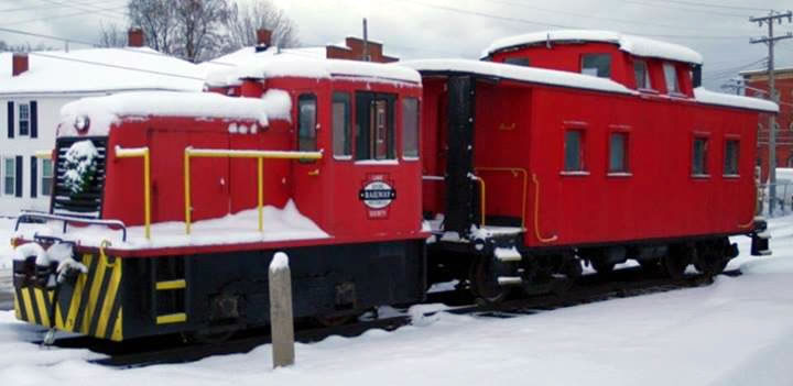 GE 25 ton and caboose all covered in snow and ready for Christmas at the Station 2013