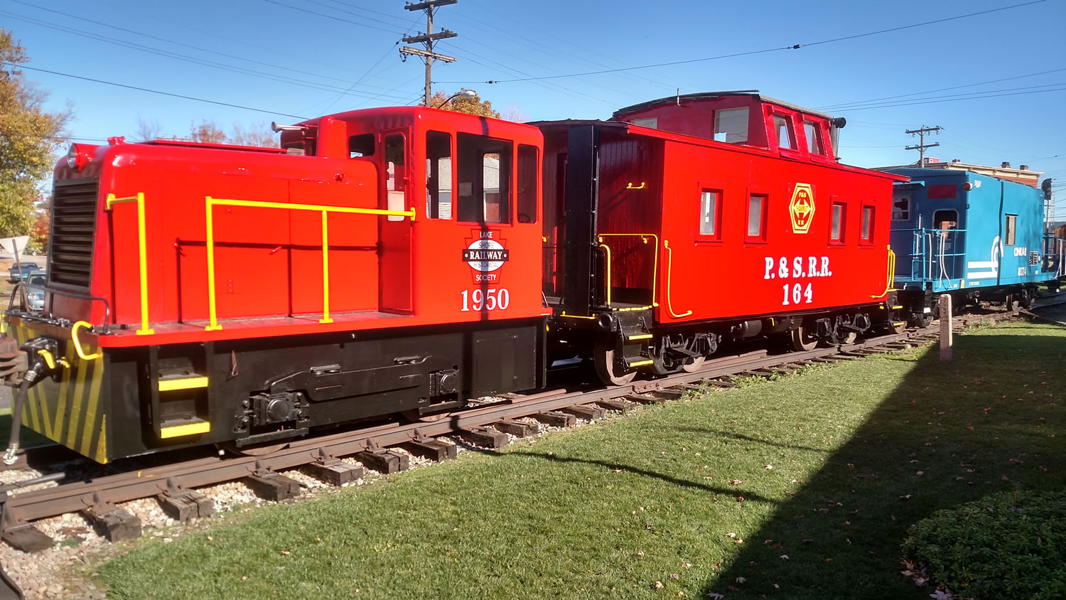 Our current front lineup at the Lake Shore Railway Museum. Our GE 25 tonner, the Pittsburg and Shawmut caboose and our latest addition , a Conrail caboose.